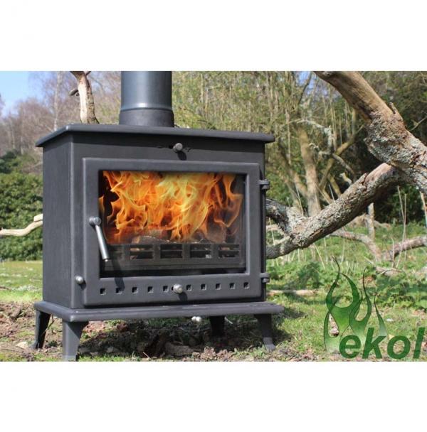 Ekol Crystal 12 woodburning stove by a tree