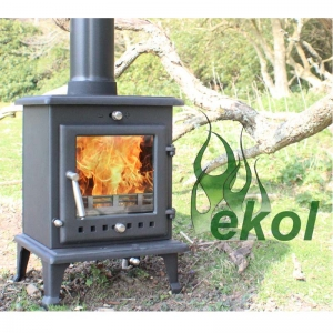 Ekol Crystal 5 woodburning stove multi fuel by a tree